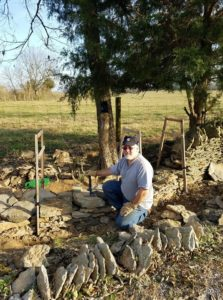 Walter Pond repairing a dry stone wall at his home in Harrodsburg, KY.