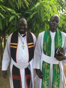 Jacob joining Pastor Makol Ngong in worship on July 1st at St. Matthew Church Parish, Sherikat, Juba, South Sudan.