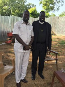 Jacob visiting with his brother-in-law, in Bor, South Sudan. July 2018.