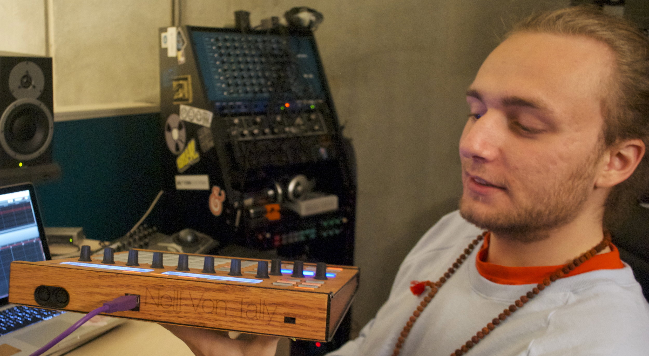 """You can pretty much do anything with a laser cutter,"" Von Tally says, holding up his custom wood framed Maschine production system."