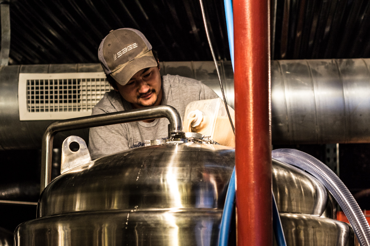 dominic of manitou brewing adds the yeast