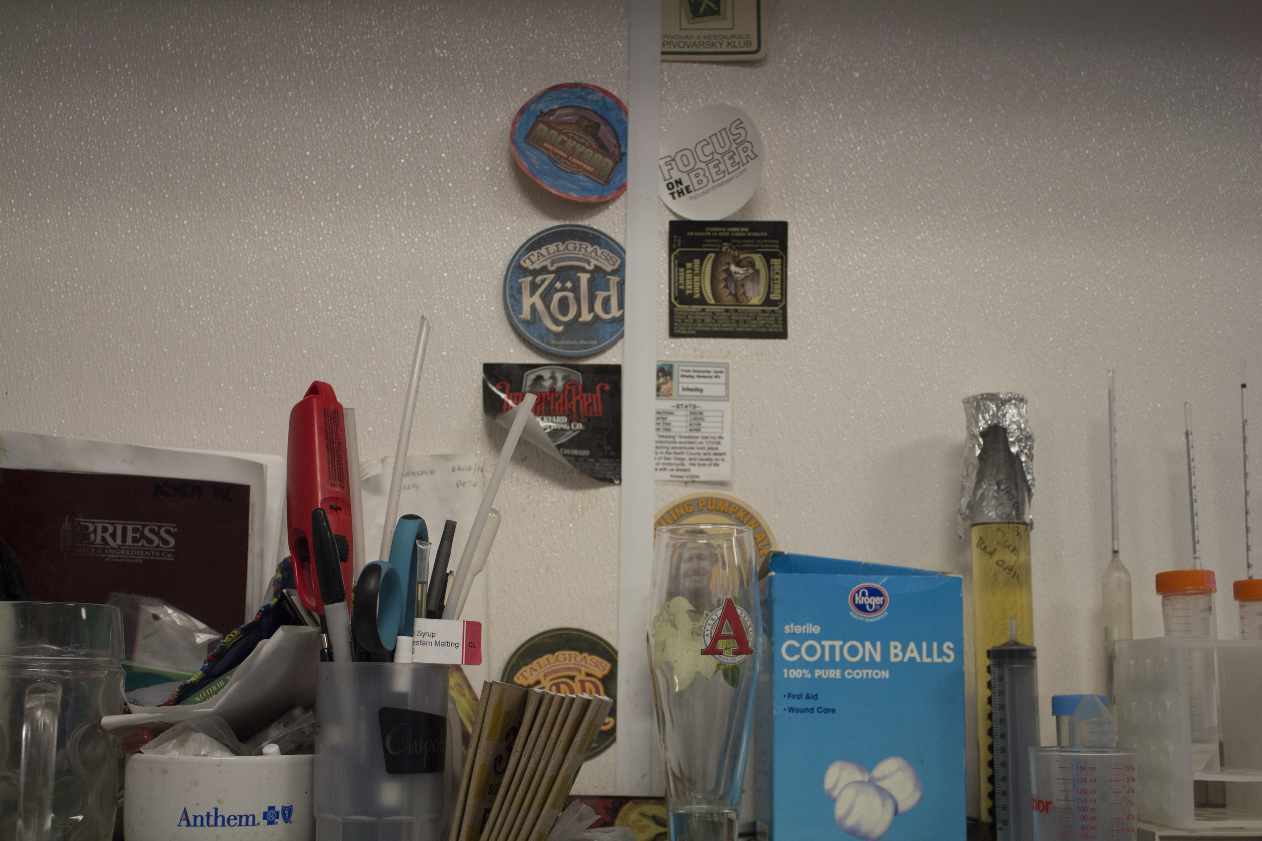 Mid-way through the day, I noticed a familiar white sticker on the wall in the brewhouse...
