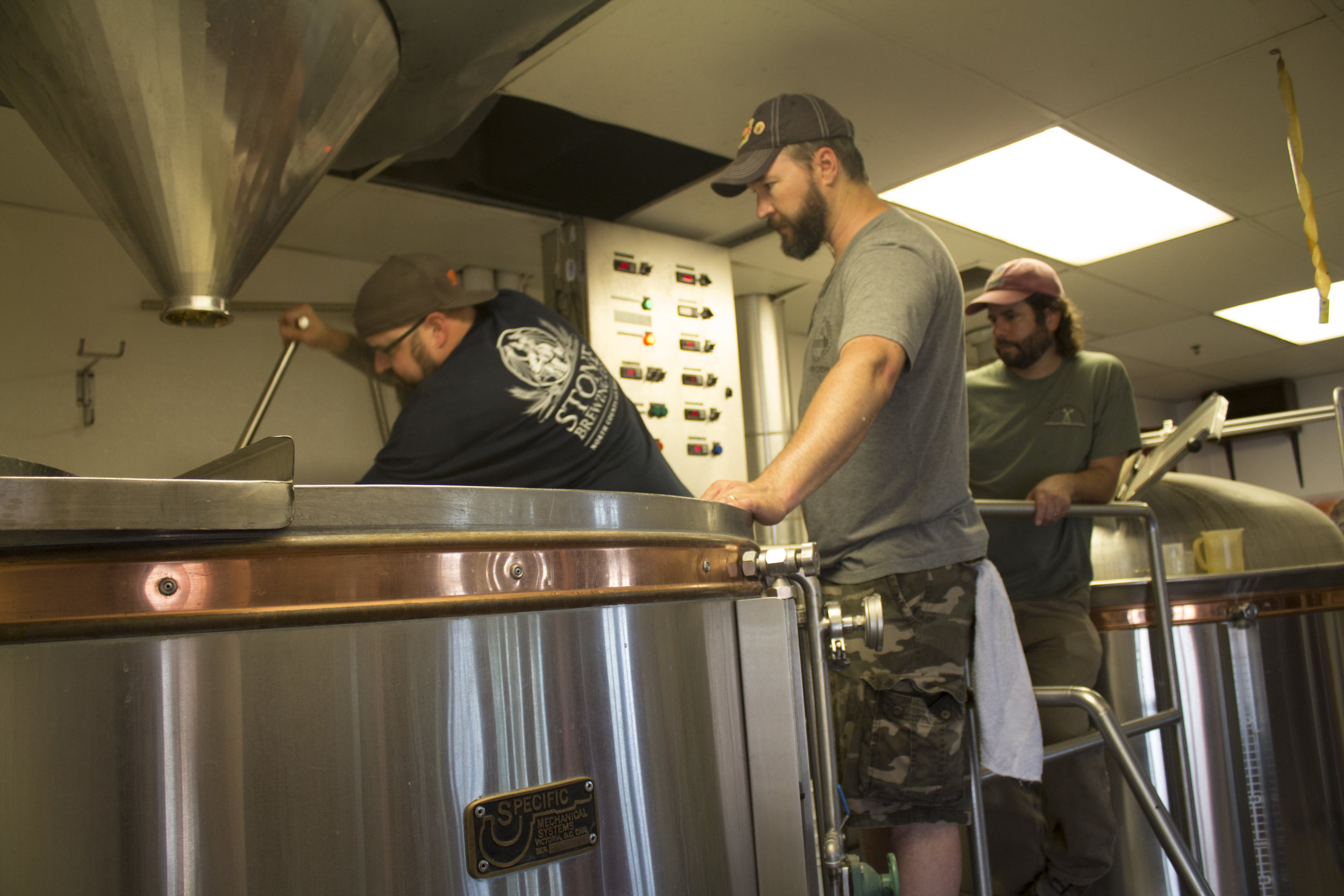 Stirring 700+ pounds of grain and water is hard work.  Everyone took turns giving the mash a spin.