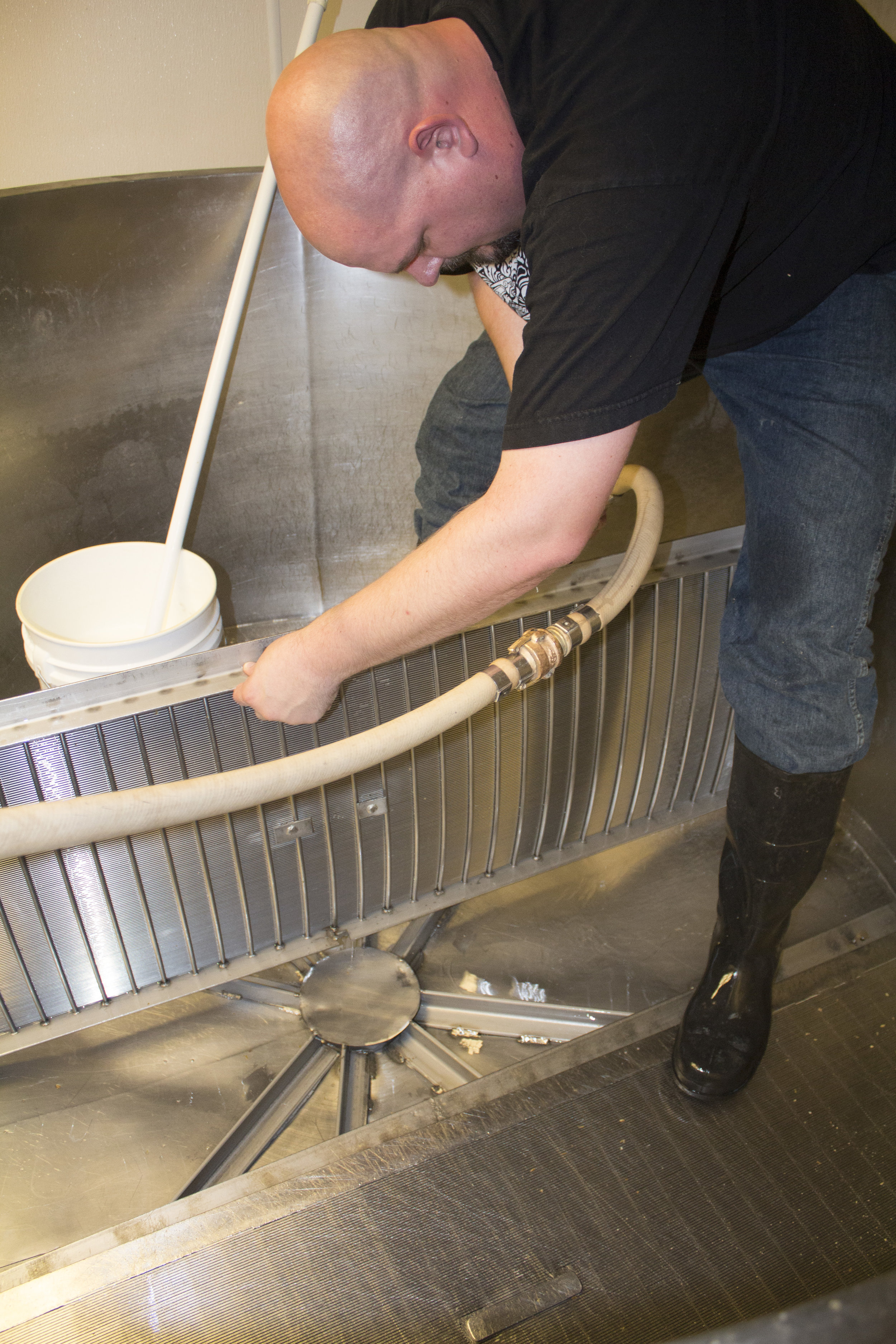 I'm not clear on how I ended up cleaning the mash tun, but I had a good time doing it. I only whacked my head on the grain chute once.