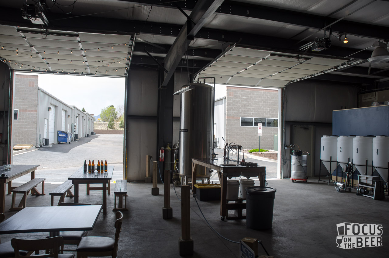 To the left is the tasting area, to the right is Colorado Common's production space.