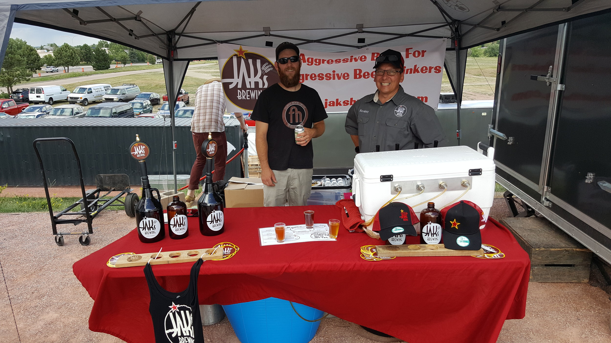 Jak's Brewing tent with Travis from Fieldhouse.