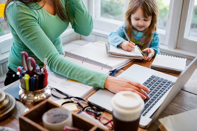 Mother and daughter (4-5) in home office --- Image by © mother image/redshorts/Corbis