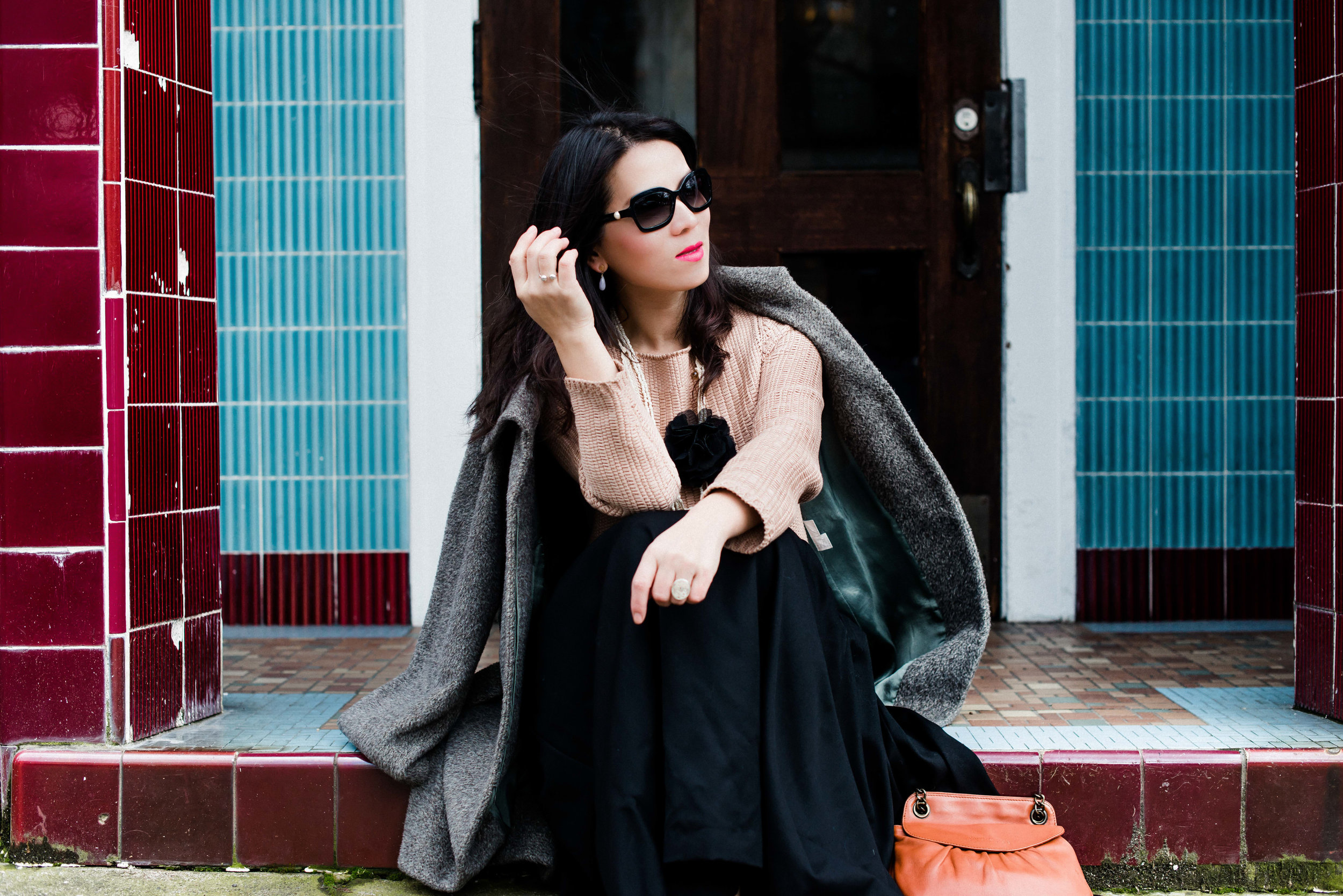 pink sweater with long black skirt and camel long coat-7597