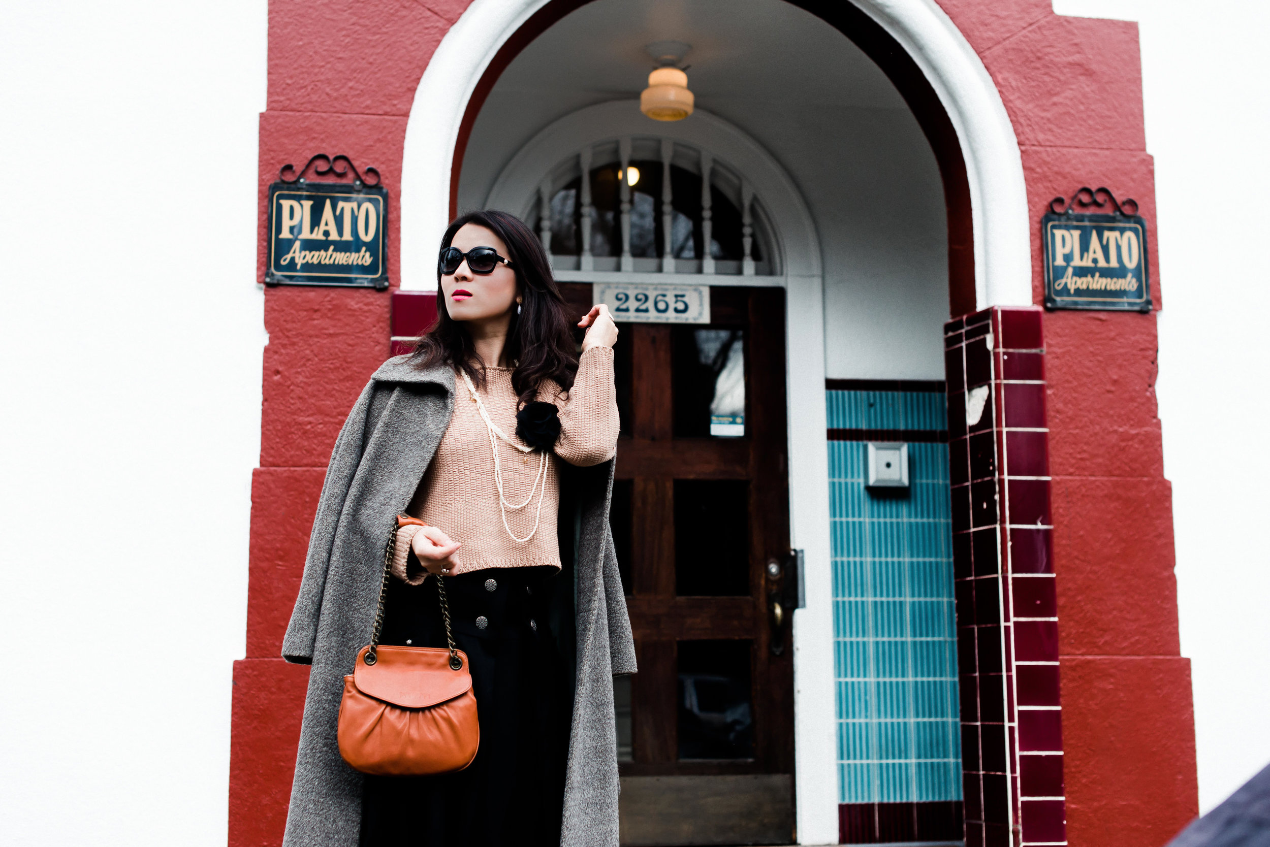 pink sweater with long black skirt and camel long coat-7581