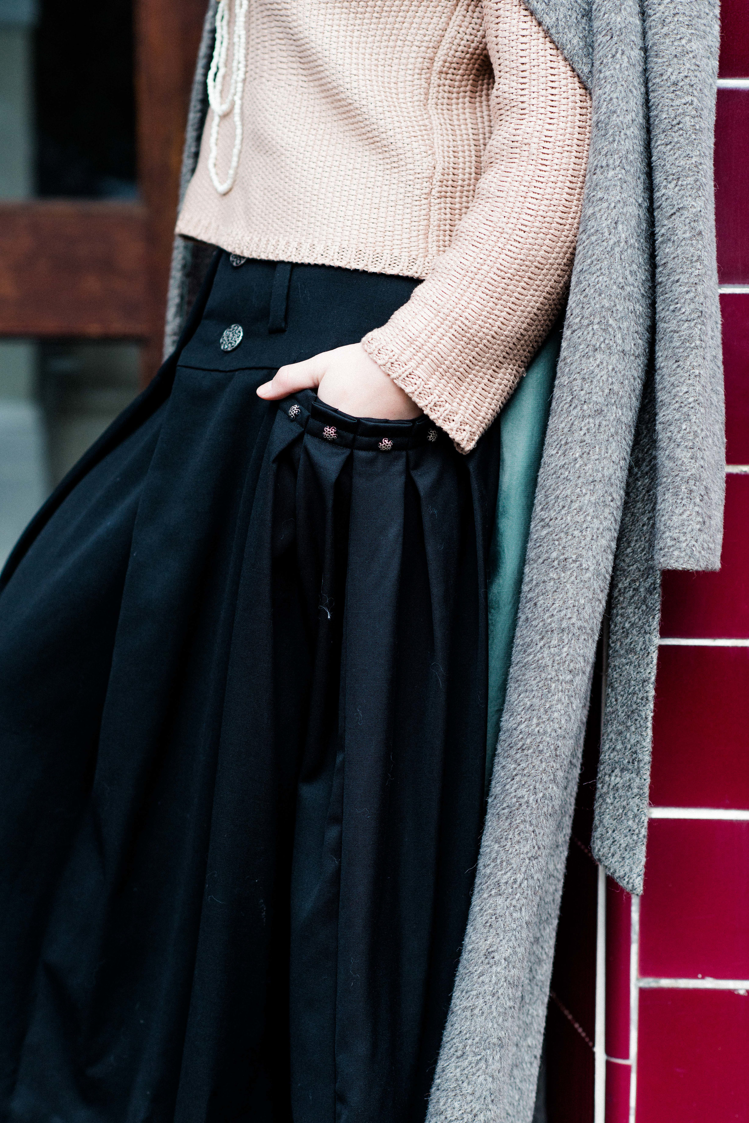 pink sweater with long black skirt and camel long coat-7648