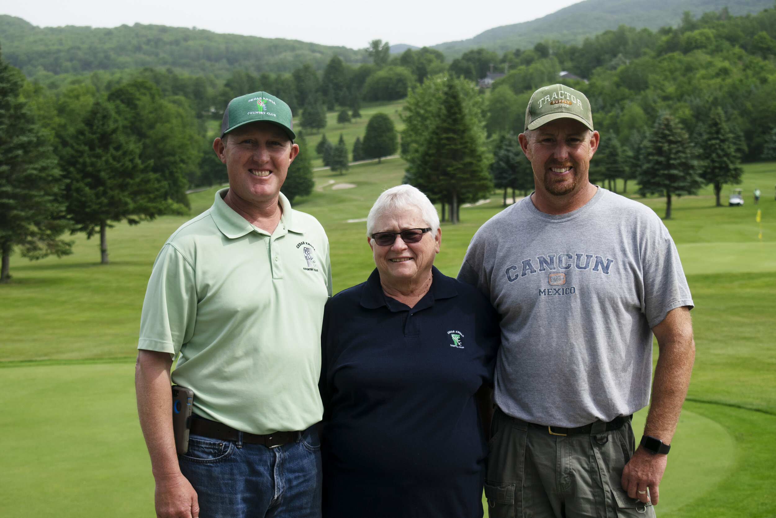 Fromleft: Owners of Cedar Knoll Country Club Tom, Ruth, and Tim Ayer. Photo by Olivia Nye.