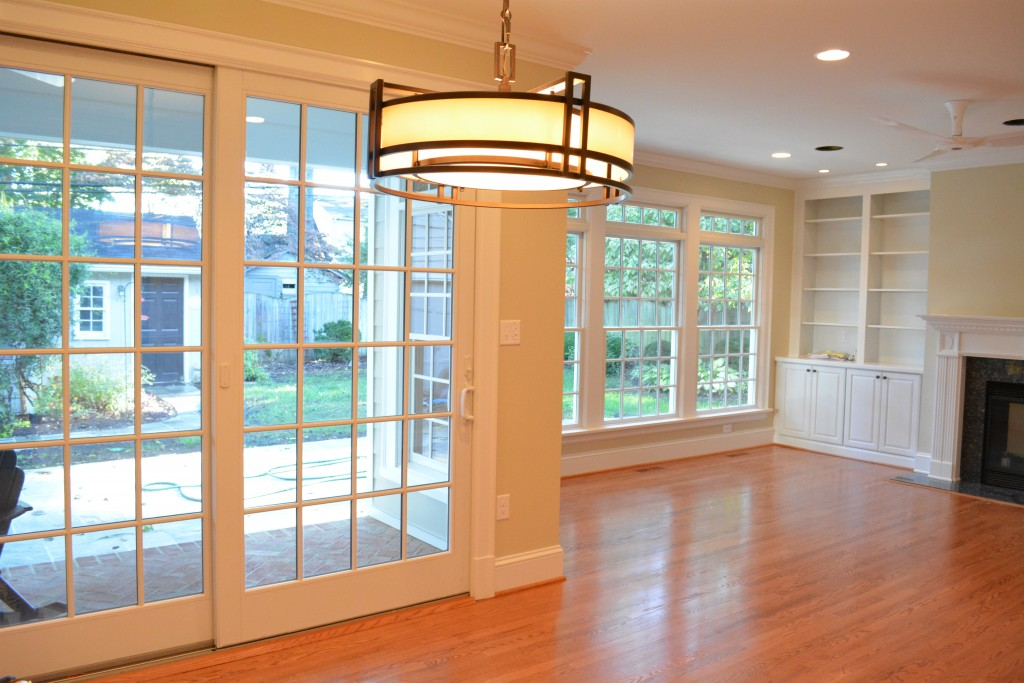 The amount of natural light in the room is due to the large Andersen windows & doors we installed. The transoms are a nice detail and allow even more light.
