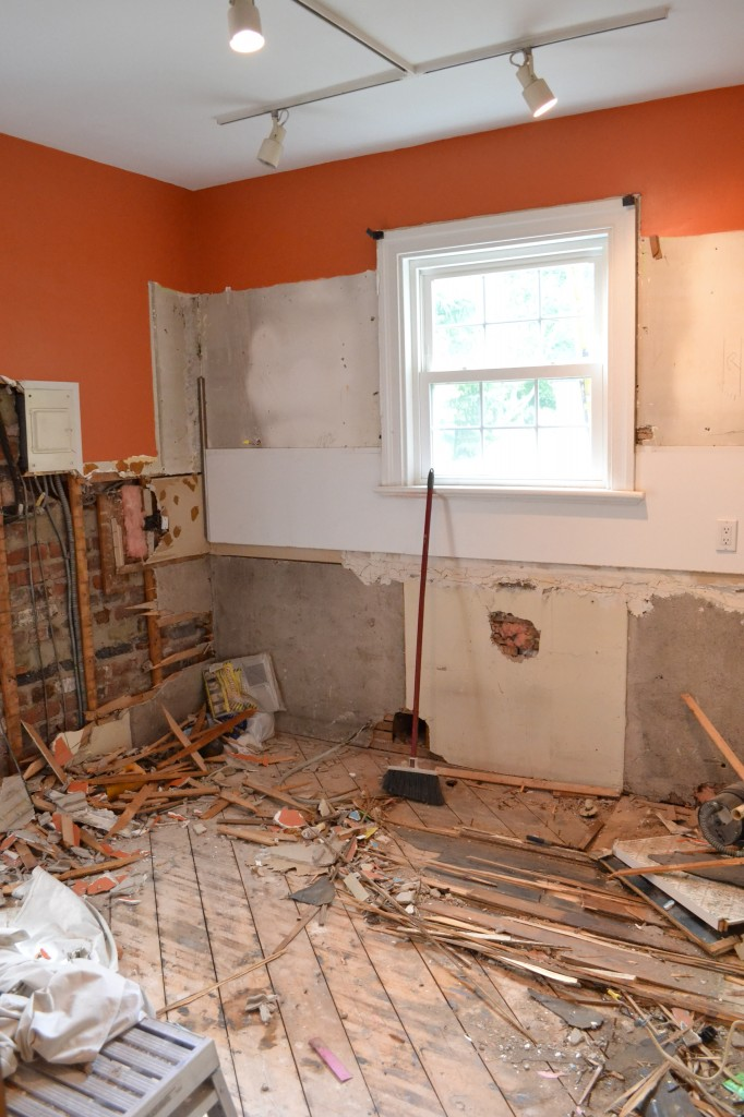 Kitchen cabinets, drywall and flooring are all making their way to the dumpster and the homeowner is thrilled.