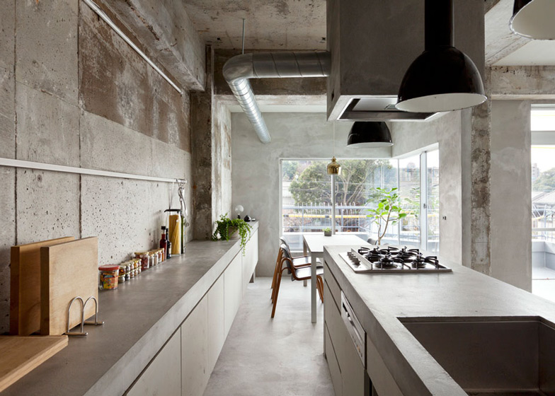 Bare-concrete-apartment-by-Airhouse-Design-Office-presents-its-own-fashion-exhibitions_dezeen_ss_1