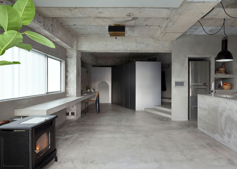 Bare-concrete-apartment-by-Airhouse-Design-Office-presents-its-own-fashion-exhibitions_dezeen_ss_10