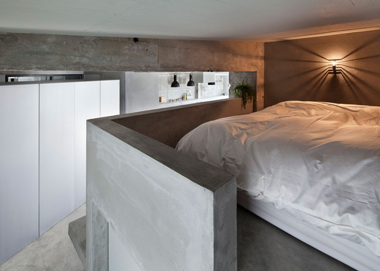 Bare-concrete-apartment-by-Airhouse-Design-Office-presents-its-own-fashion-exhibitions_dezeen_ss_11