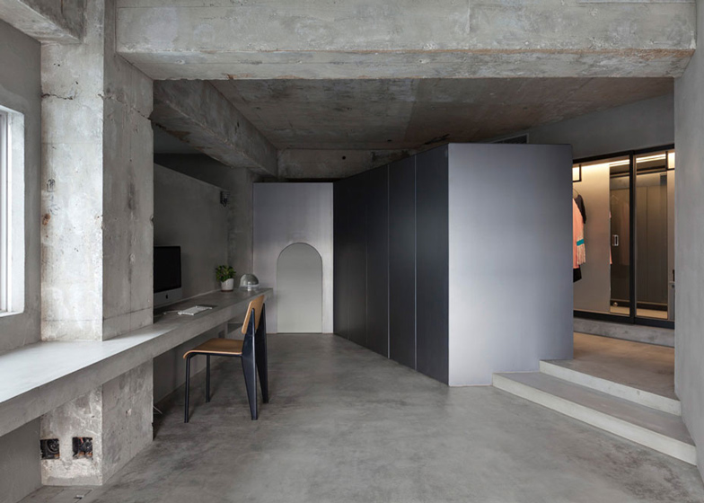 Bare-concrete-apartment-by-Airhouse-Design-Office-presents-its-own-fashion-exhibitions_dezeen_ss_13
