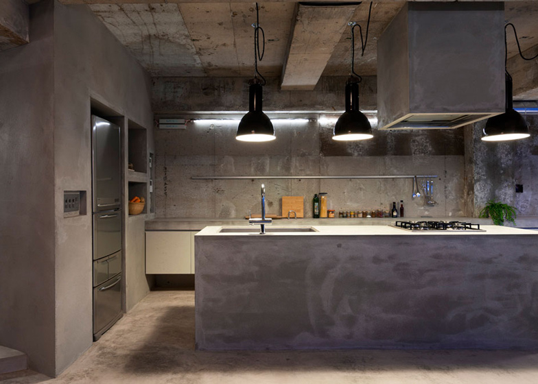 Bare-concrete-apartment-by-Airhouse-Design-Office-presents-its-own-fashion-exhibitions_dezeen_ss_14