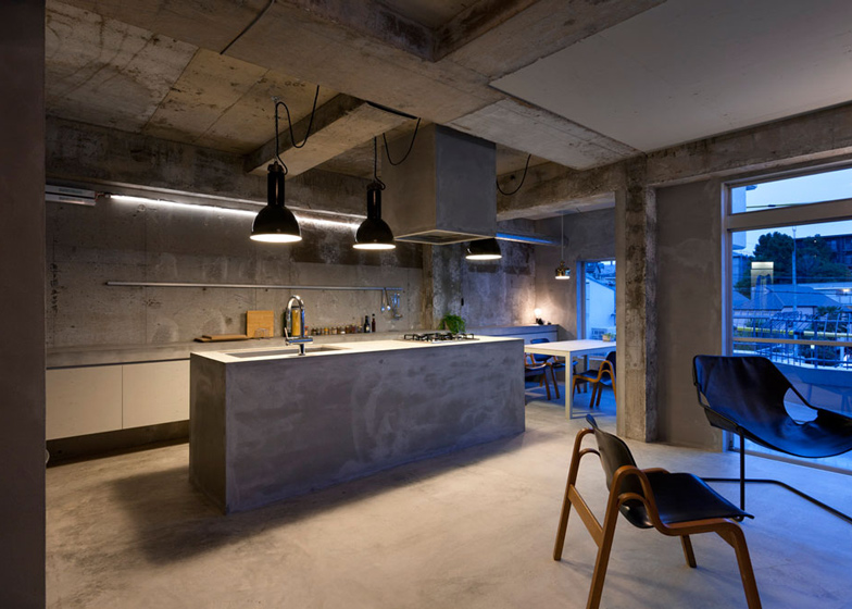 Bare-concrete-apartment-by-Airhouse-Design-Office-presents-its-own-fashion-exhibitions_dezeen_ss_15