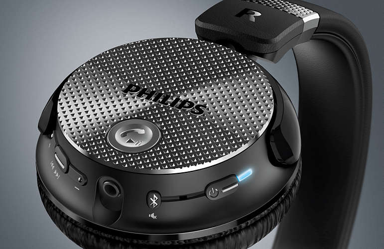 Close-up of the Philips SHB8850NC headphones Bluetooth and Power buttons