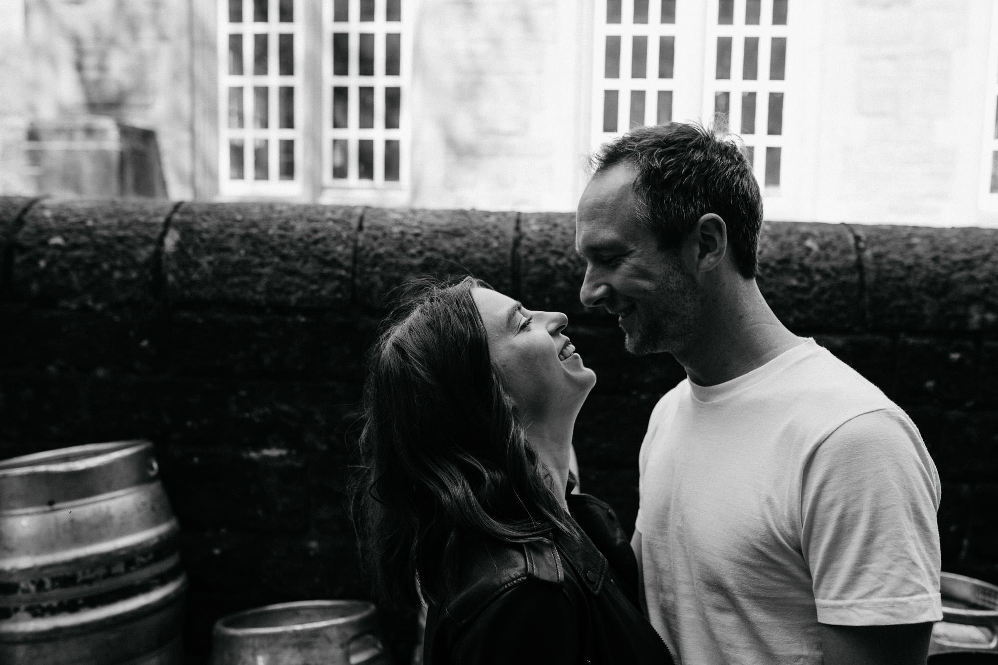 Pre-wedding photograph in Yorkshire, black and white photo, couple smiling at each other