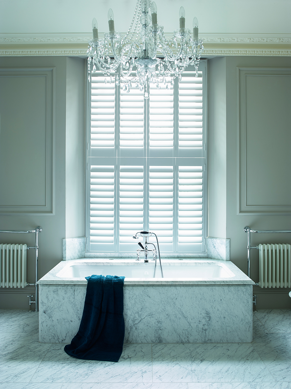 Shutterly Fabulous - French For Pineapple Blog - White Tier On Tier Plantation Shutters in glamourous bathroom with chandelier and wall moulding