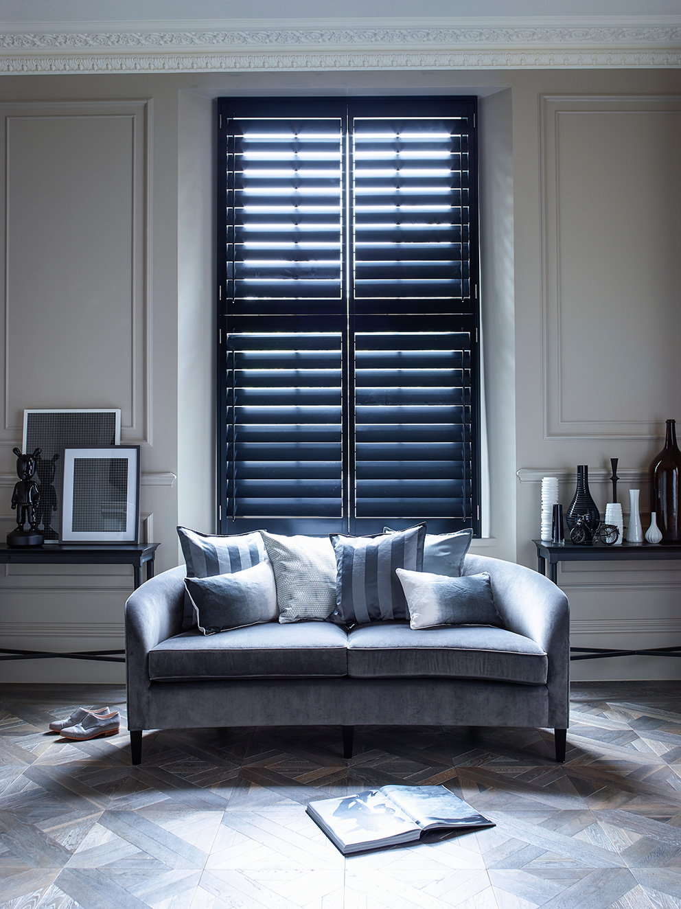 Shutterly Fabulous - French For Pineapple Blog - Black Plantation Shutters in glamorous living room with grey sofa and parquet floor