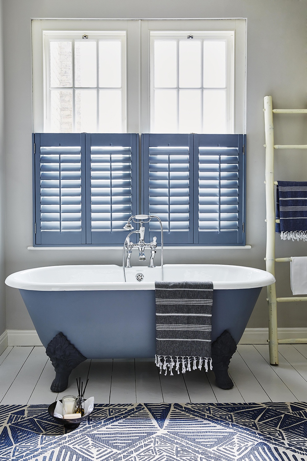 Shutterly Fabulous - French For Pineapple Blog - cafe style blue shutters in bathroom with blue freestanding bath and blue and white rug