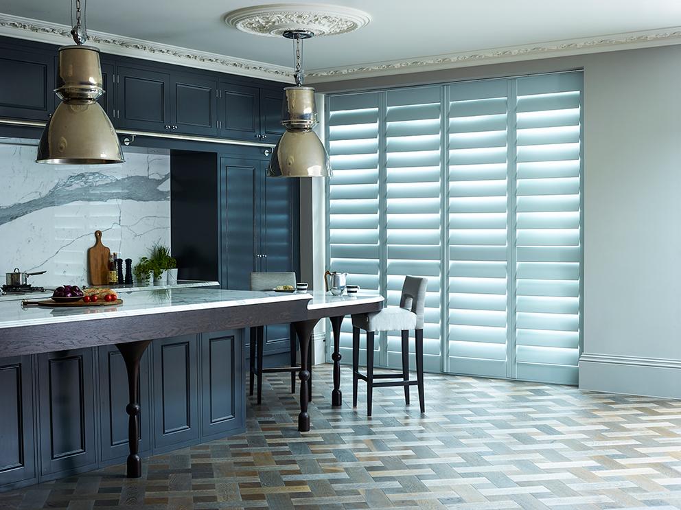 Shutterly Fabulous - French For Pineapple Blog - Slatted Door Shutters in stunning black kitchen with marble splashback and worktops