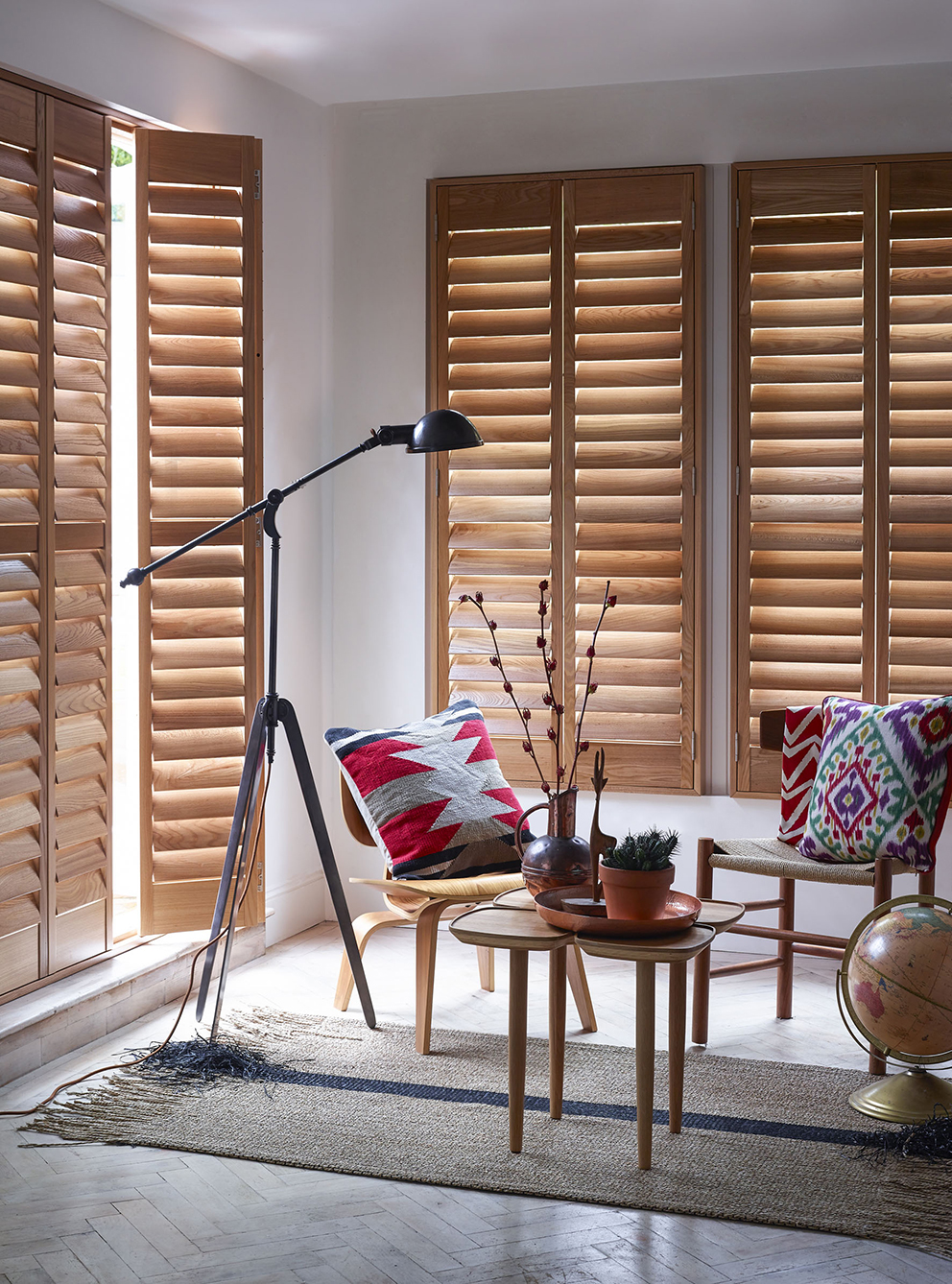 Shutterly Fabulous - French For Pineapple Blog - natural wood window and door shutters in neutral sitting area with parquet floor