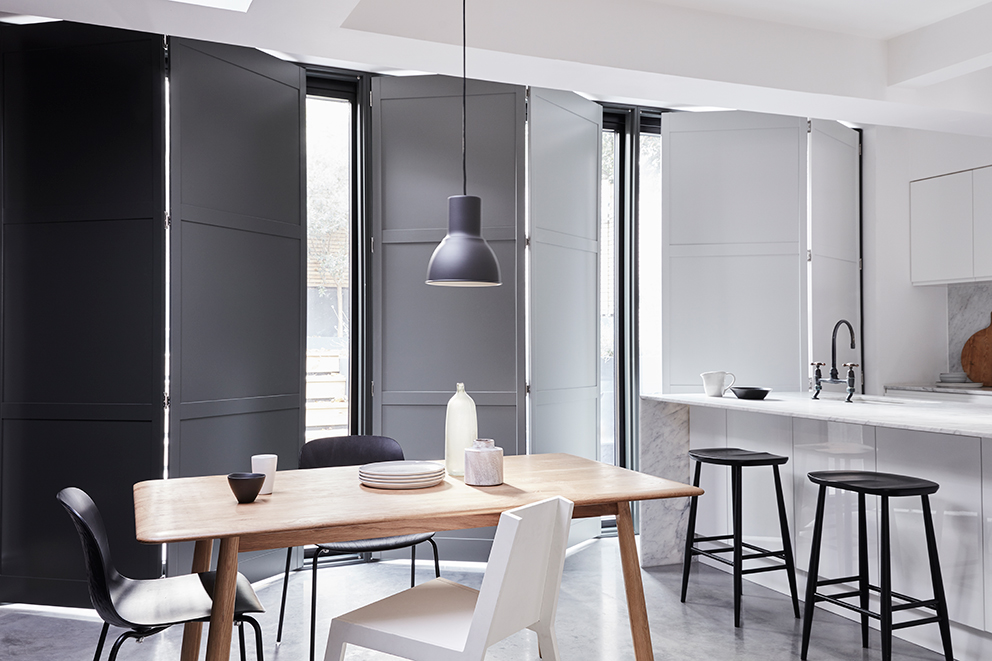 Shutterly Fabulous - French For Pineapple Blog - sold door shutters on tracks in modern kitchen with marble worktops