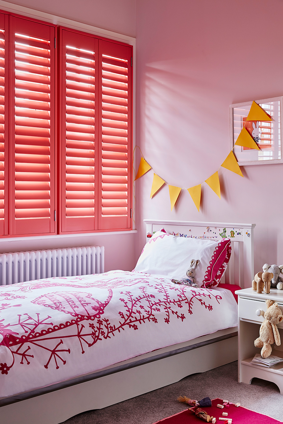 Shutterly Fabulous - French For Pineapple Blog - pink shutters in childs bedroom with yellow bunting