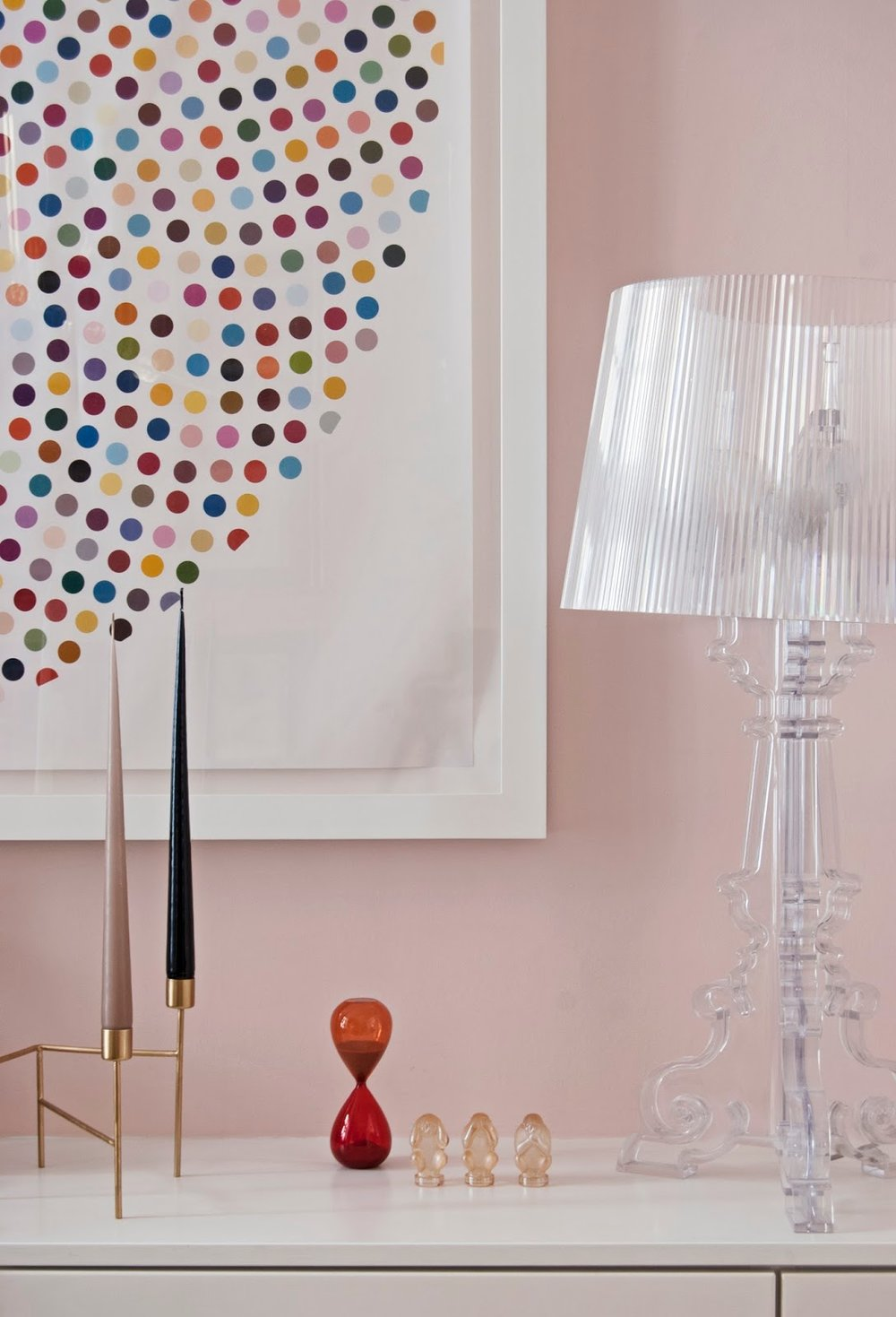 Amara Shoppable Home Inspiration Pages - French For Pineapple Blog - sideboard with damien hirst valium print, candle holder, hay egg timer, see no evil, hear no evil, speak no evil crystal monkeys lalique.