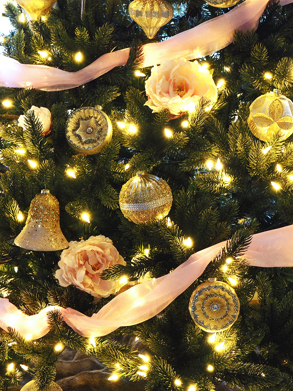 French For Pineapple Blog - Trees & Baubles Balsam Hill Christmas Blog Hop - close up of gold glitter christmas tree decorations and baubles with pale pink organza ribbon and pale pink peonies and fairy lights