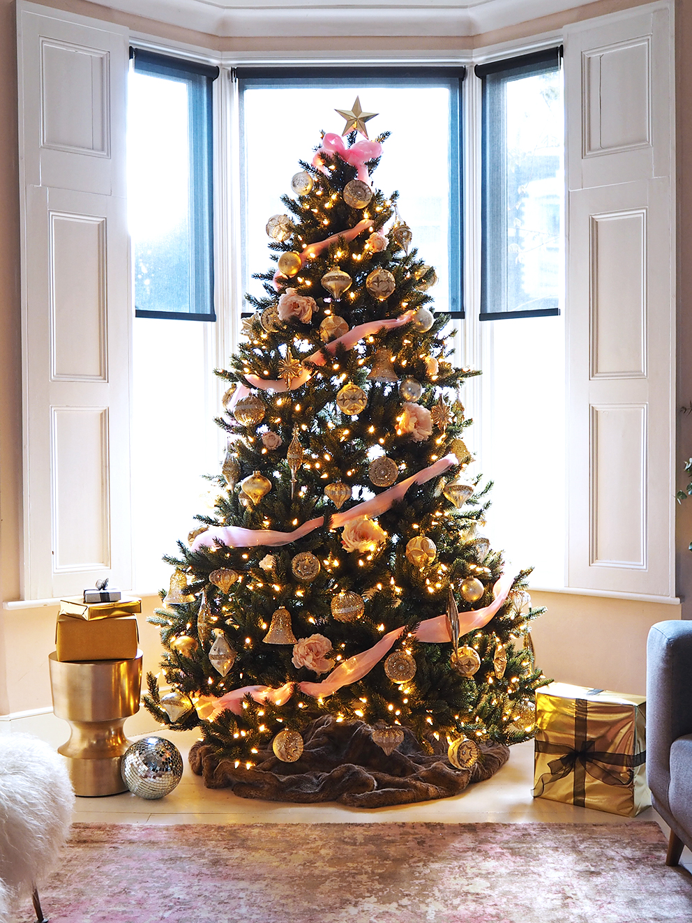 French For Pineapple Blog - Trees & Baubles Balsam Hill Christmas Blog Hop - wide shot of faux christmas tree with gold glitter baubles, pink organza wrap and pale pink peonies and fairy lights in bay window of victorian home
