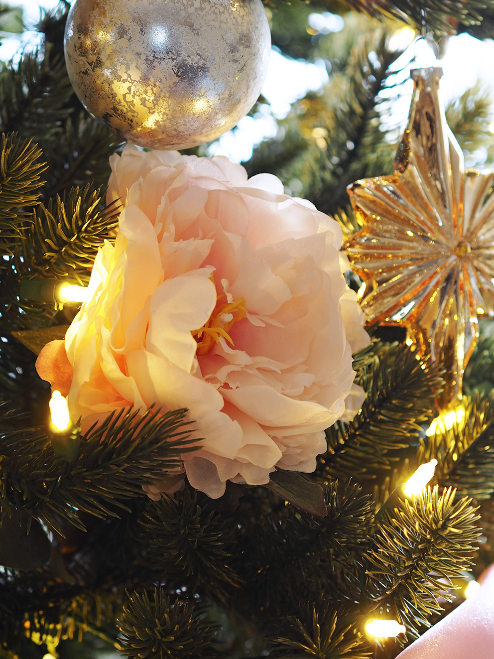 French For Pineapple Blog - Trees & Baubles Balsam Hill Christmas Blog Hop - close up of pale pink faux peony on faux realistic christmas tree and fairy lights