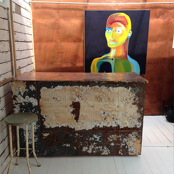 Garden studio with reclaimed tin tiles on bar and copper panelling