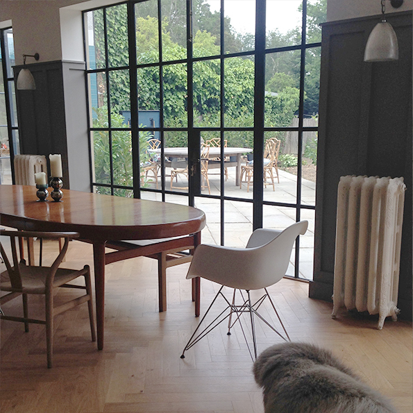 Dining area with herringbone parquet and crittall windows