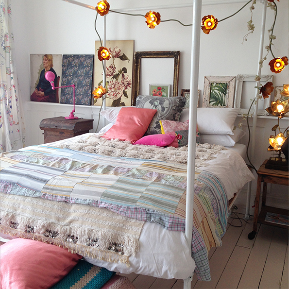 Eclectic master bedroom with layered textiles and artwork