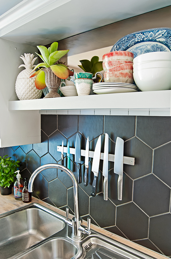Kitchen sink area with reclaimed tap and open shelf converted from plate rack