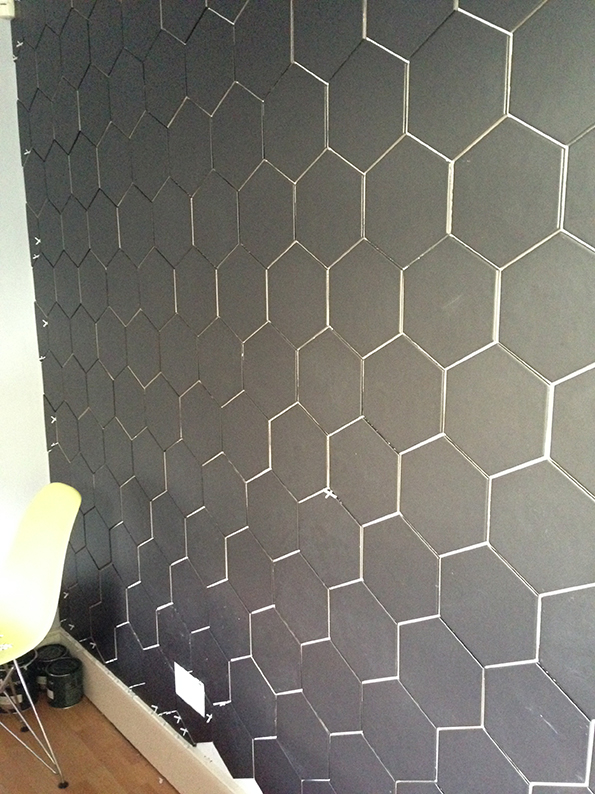 Hex tiled wall before grout