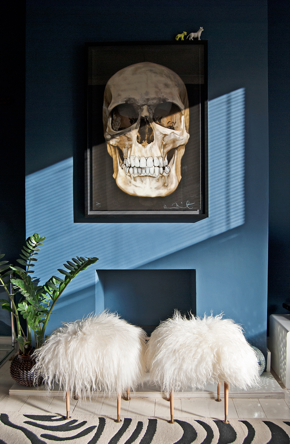 Navy Chimney Breast with Skull Print, Plants and Sheepskin Stools - French For Pineapple Blog