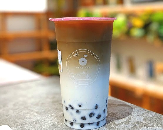 Herb tea's Genmaicha with fresh milk and sesame boba