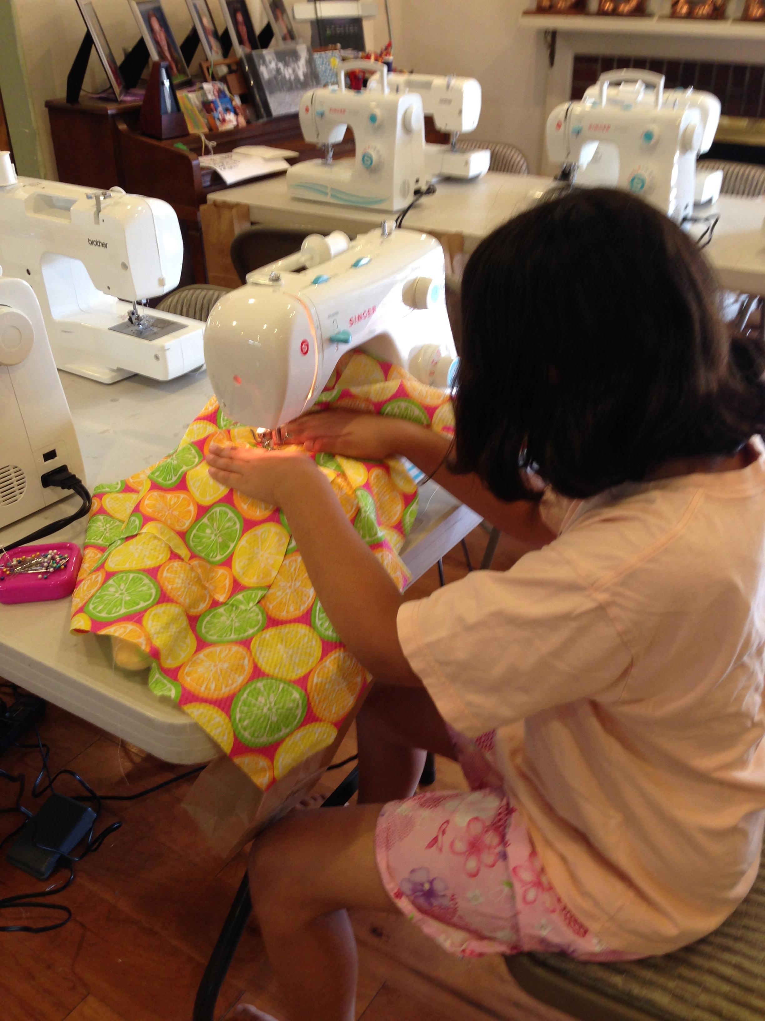 5th grader sewing.