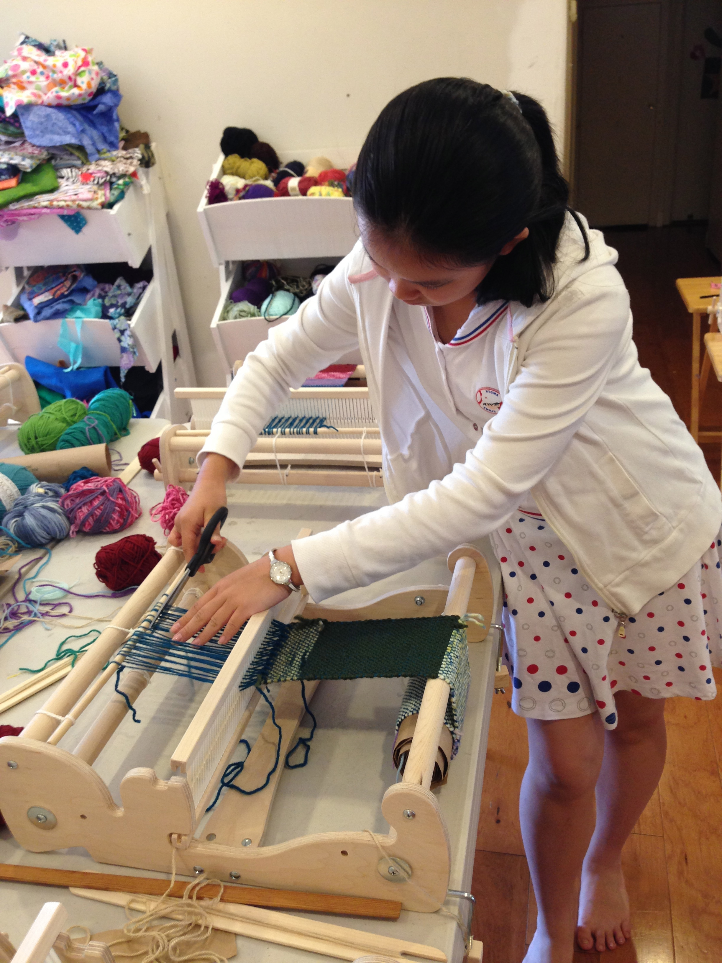 6th grader Cutting the warp.