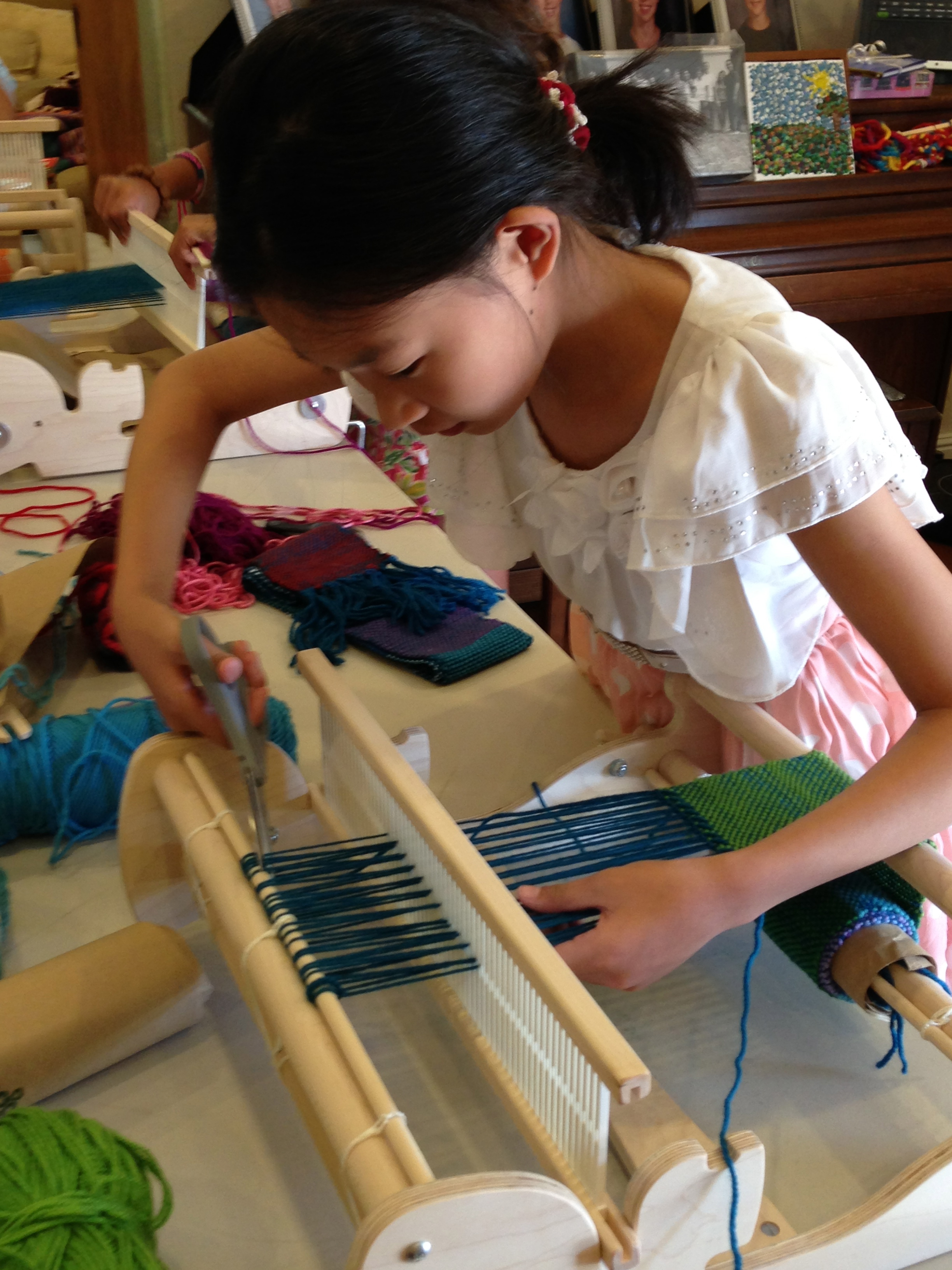 6th grader cutting her warp.