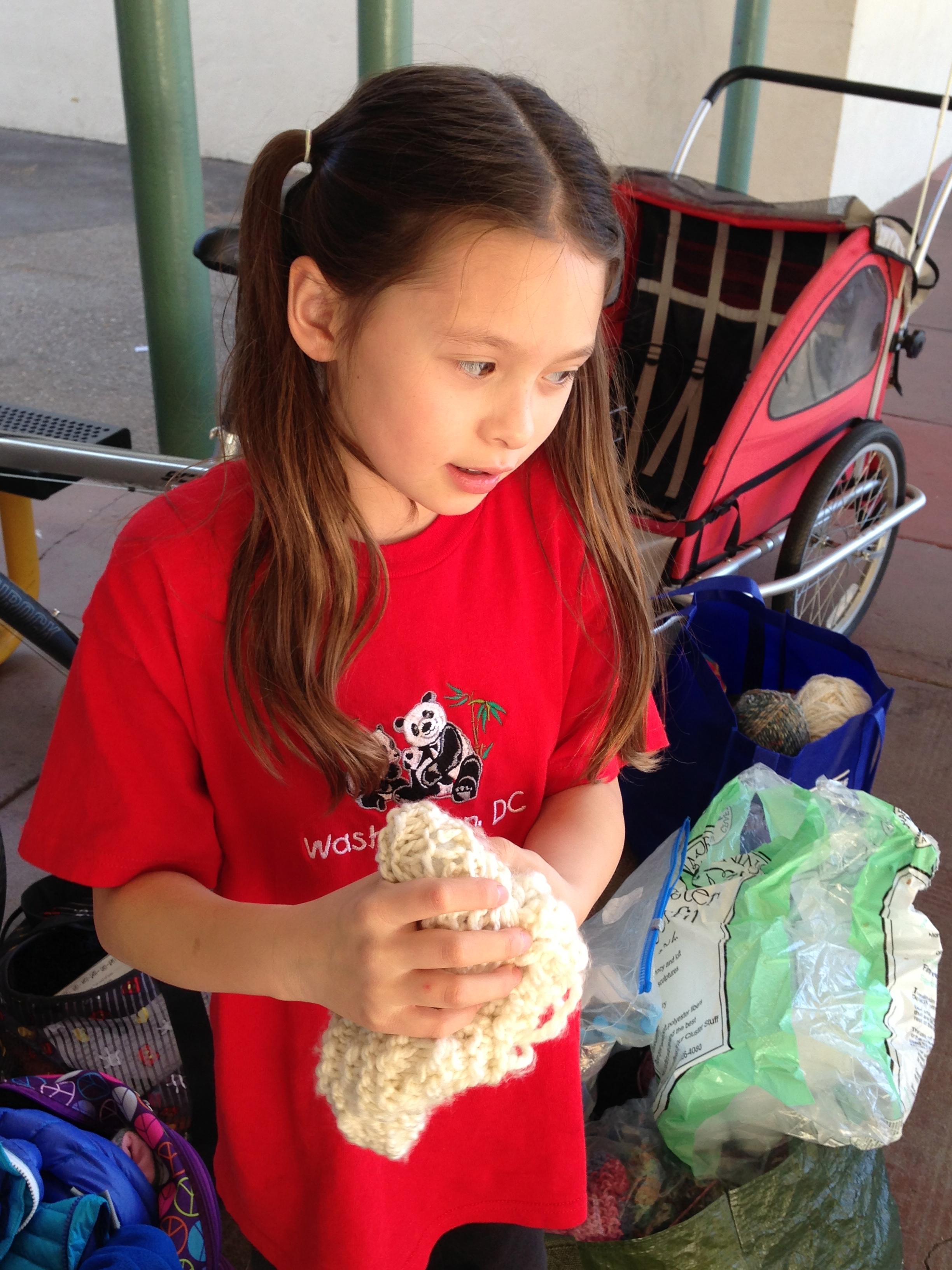 2nd grader stuffing her toy.