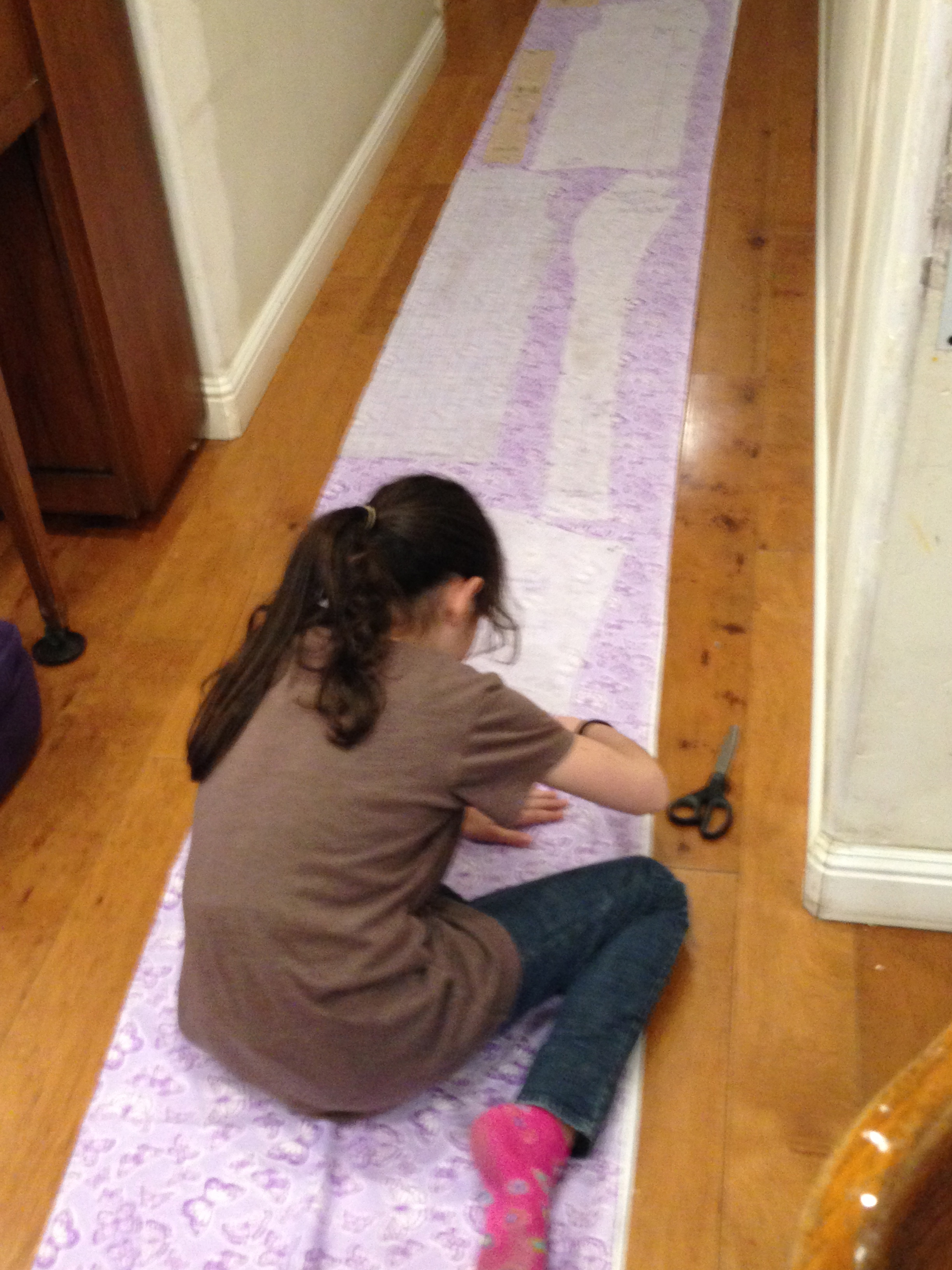Cutting fabric for her robe.