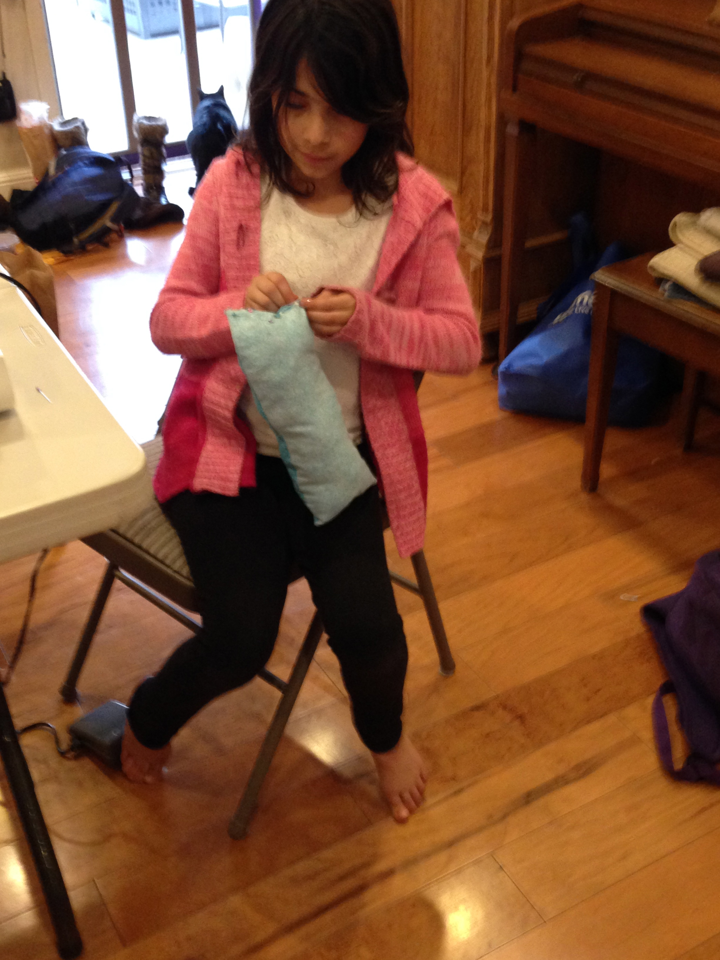 3rd grader putting the finishing touches on her pillow.