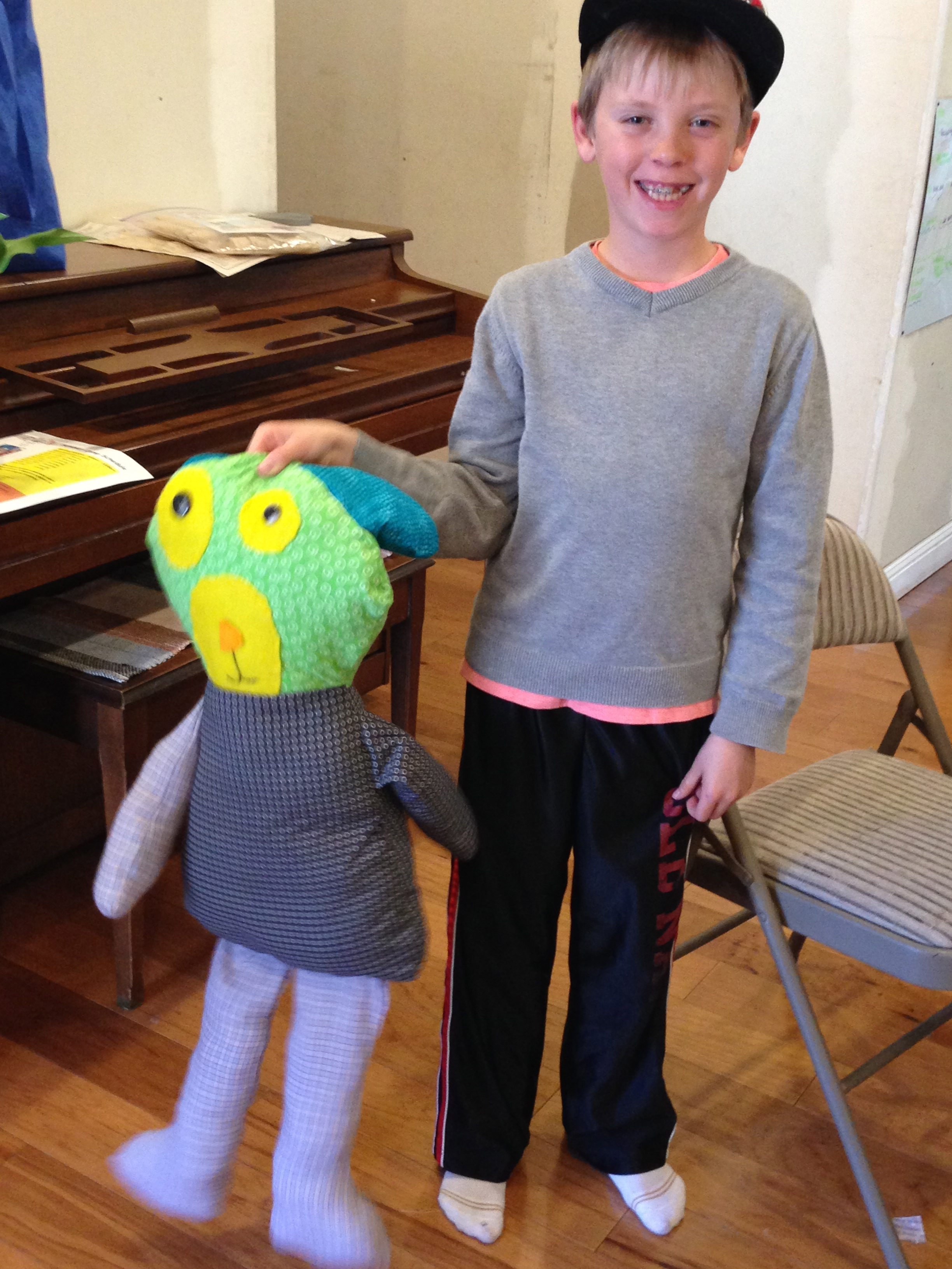 4th grader with his stuffed dog.